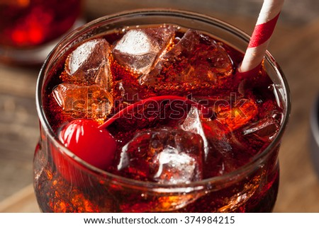 Sweet Refreshing Cherry Cola with Garnish and Straw - stock photo