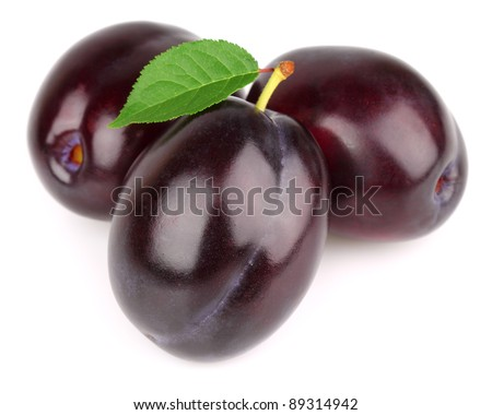Sweet ripe plums with leaves - stock photo