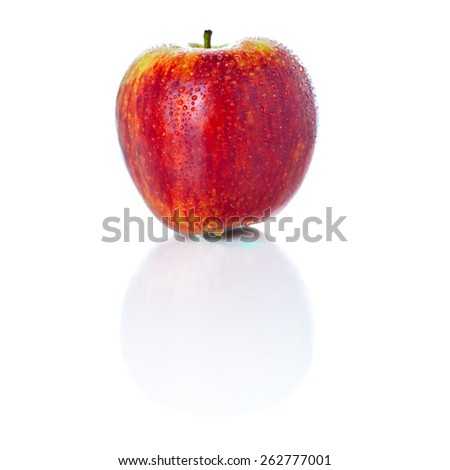 Sweet ripe red apple photographed on glass surface with reflection isolated on white background  - stock photo