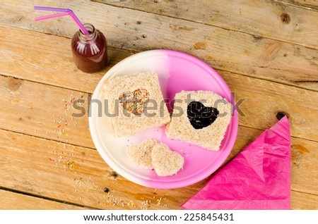 Sweet sandwich with a heart shape cut out of the bread