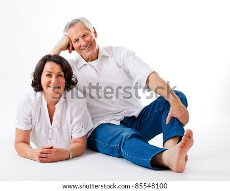 sweet senior couple on the floor with white background - stock photo