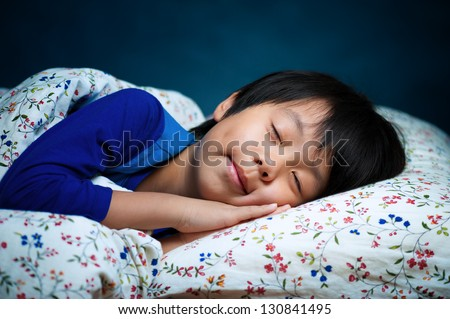 Sweet sleeping Asian child - stock photo
