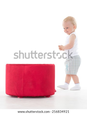 Sweet small baby playing with box on a white background. - stock photo