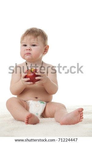 Sweet small baby with a fresh red apple on a white background. - stock photo