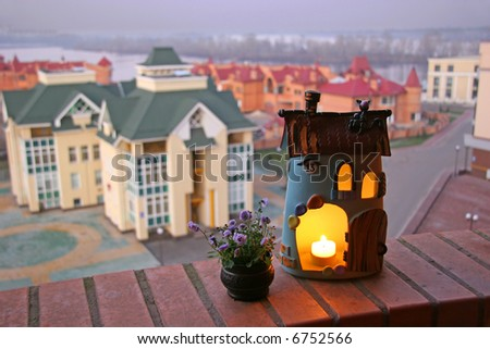 sweet small house in front of real houses - stock photo