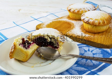 Sweet small pie on the white plate, close up.  Jam pie. Small pie. Pie. Sweet pastry. Sweet dessert - stock photo