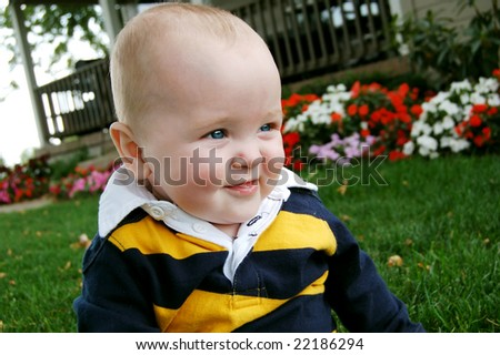 Sweet Smiling Baby Outside - stock photo