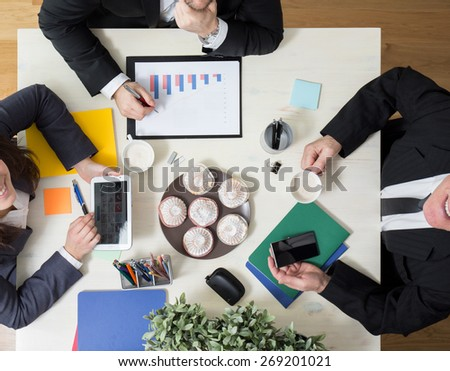 Sweet snack on business meeting - stock photo