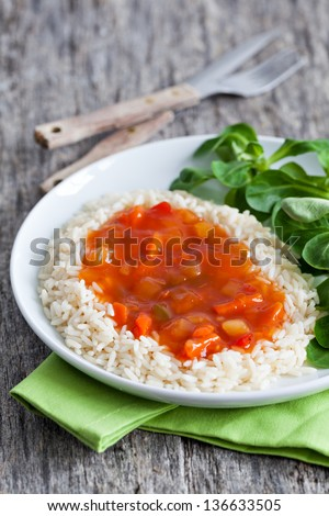 sweet sour with rice and salad