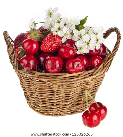 Sweet strawberry and cherries with flowers in basket isolated on white background - stock photo