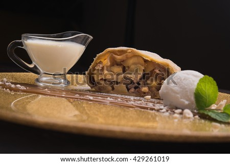 sweet strudel with ice cream ball in restaurant - stock photo