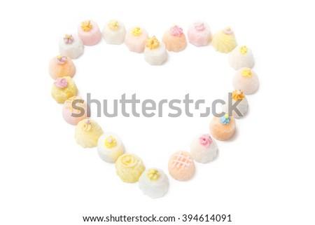 Sweet sugar cupcakes. Heart  figure - stock photo