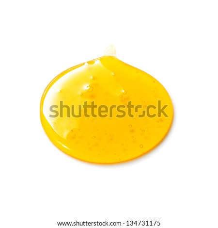 Sweet syrup drop isolated on white background - stock photo