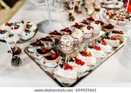 A plate of cakes and muffins with cream with berries. Table with & Sweet Table Plate Cakes Muffins Cream Stock Photo (Royalty Free ...