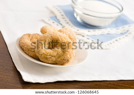 Sweet taralli closeup with sugar on the background - stock photo