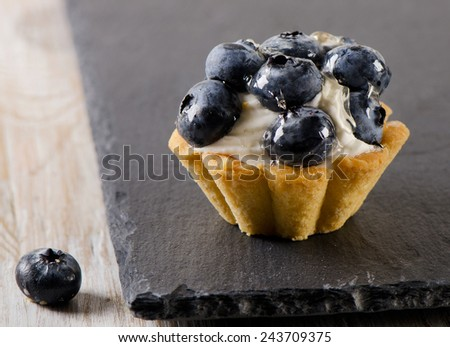 Sweet tart with fresh  blueberries. Selective focus - stock photo