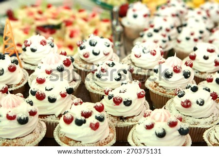 Sweet tasty cakes are on the table - stock photo