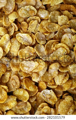 Sweet tasty krispy of cereal cornflakes with frosting on closeup food background, vertical photo - stock photo