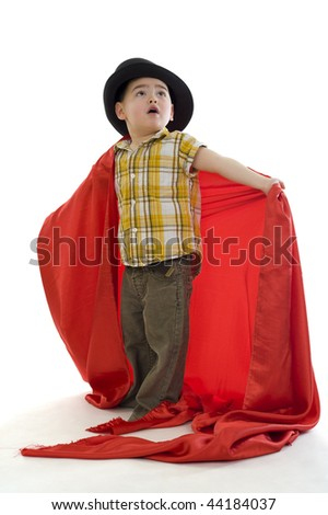 sweet thai-english boy with hat and red silk fabric, isolated on white - stock photo