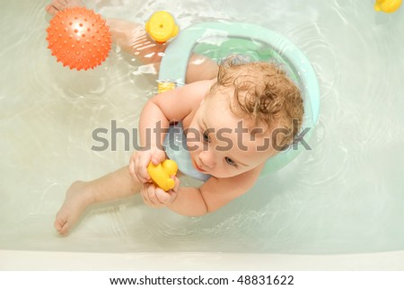 sweet toddler baby boy in bath. top view - stock photo
