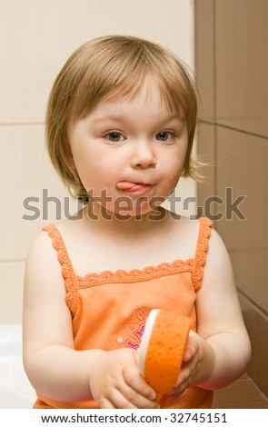 sweet toddler baby girl cleaning teeth - stock photo