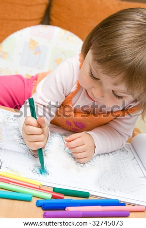 sweet toddler baby girl drawing
