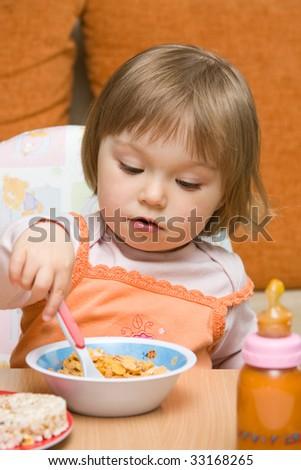 sweet toddler baby girl eating - stock photo