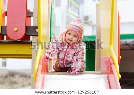 sweet toddler girl on the playground - stock photo