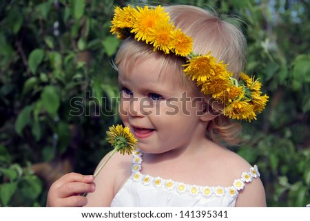 Sweet toddler girl with floral head wreath on