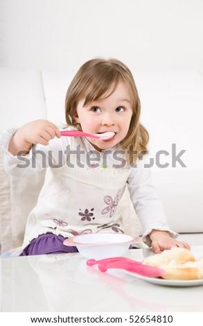 sweet toddler little girl eating - stock photo