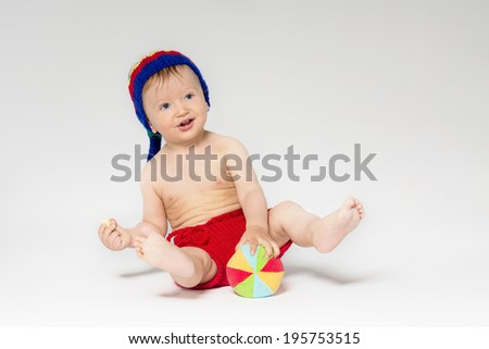 Sweet toddler with a ball