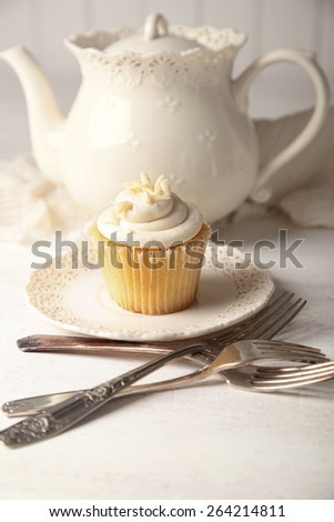 Sweet vanilla cupcake ready to eat - stock photo