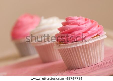 sweet vanilla pink and white cupcakes - stock photo