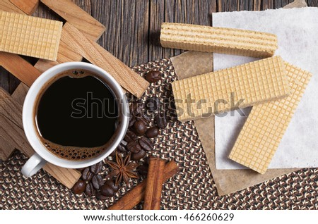 Sweet waffles and cup of hot coffee for breakfast on dark wooden table