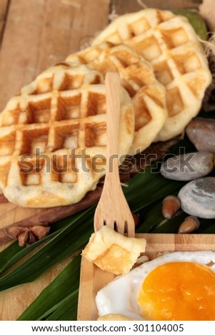 Sweet waffles and fresh milk with jam and egg heart