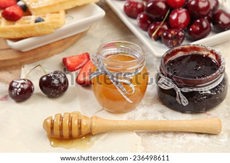 Sweet waffles with honey and berries - stock photo