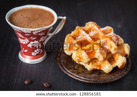 Sweet waffles with honey and coffee - stock photo