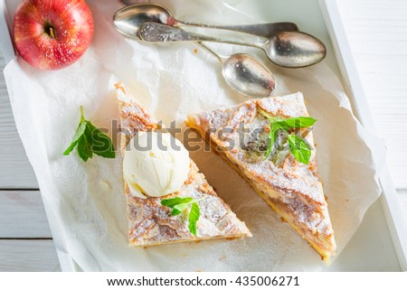 Sweet wanilla ice cream and apple pie with mint leaves - stock photo