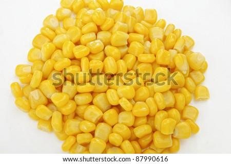 Sweet whole kernel corn on white - stock photo