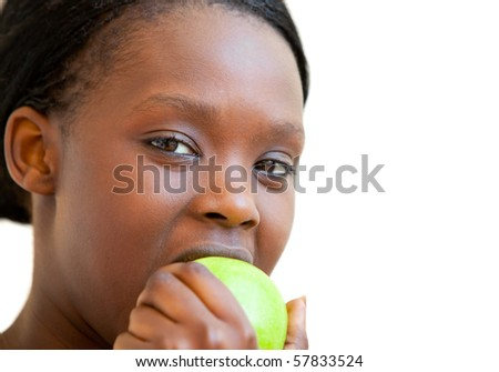 Sweet woman eating apple against a white background - stock photo