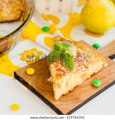 sweet yellow homemade pear pie on white background - stock photo