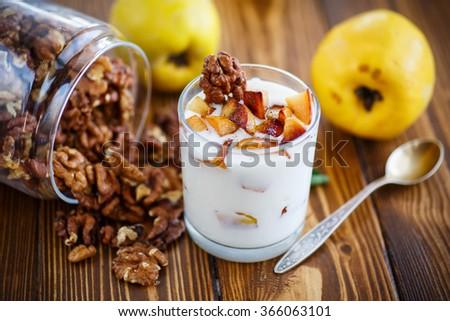sweet yogurt with baked quince - stock photo