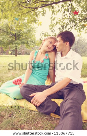 sweet young couple looking to the eyes - stock photo