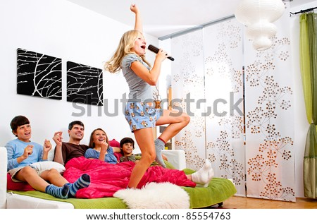 sweet young family having fun at home - stock photo