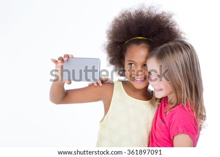 sweet young girl have fun with a telephone isolated on a white background - stock photo