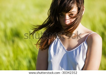 Sweet young woman on green meadow. - stock photo