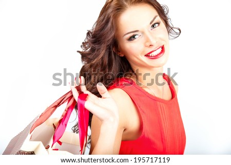 sweet young woman with shopping bags on white background isolated - stock photo