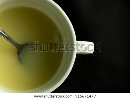 Sweetened condensed milk in a coffee cup