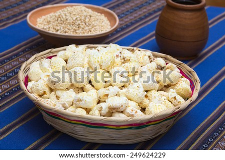 Sweetened popped white corn called Pasancalla eaten as snack in Bolivia served in a woven basket, photographed with natural light (Selective Focus, Focus in the middle of the snack)      - stock photo