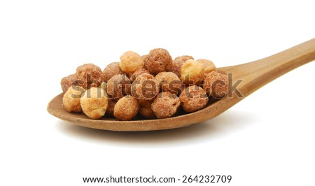 Sweeteted crunchy corn cereal made with real peanut butter and cocoa and wooden spoon on white background  - stock photo